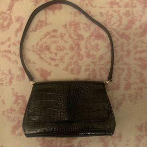 Cute stylish black alligator design purse.